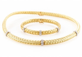 This 24kt gold with diamond accent woven jewelry suite is one of thousands of items consigned to BRG. | BRG