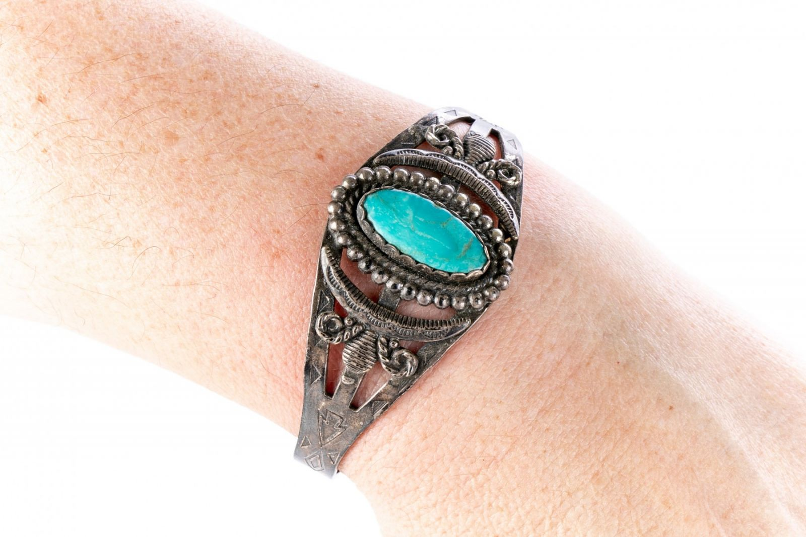 Native American jewelry and sterling silver cuff with turquoise
