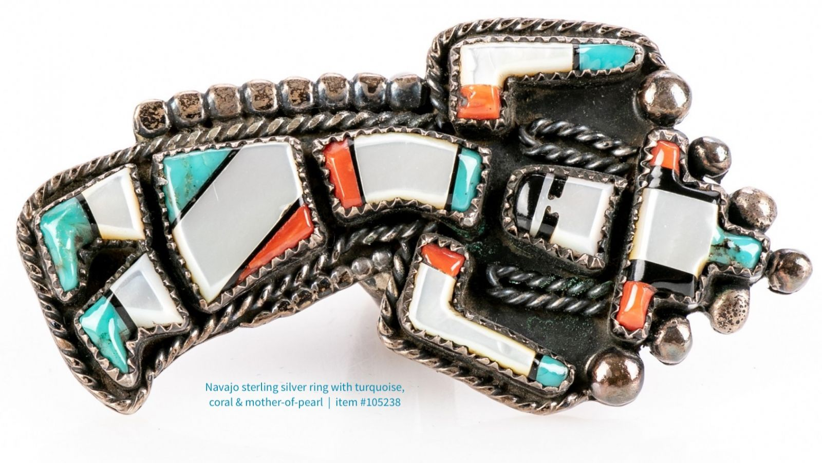 Use of natural materials including turquoise, coral, and mother-of-pearl are indicative of Native American jewelry style